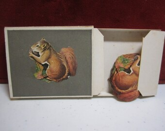 Vintage 1920's Dennison's die cut unused Animal seals in the original box of Squirrel eating a nut