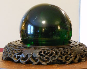 Dark Green Orb on a Wooden Stand