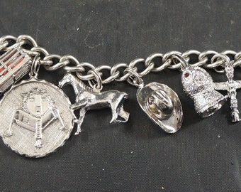 Sterling Silver CHARM BRACELET with 11 Charms Total WEIGHT 54 Grams