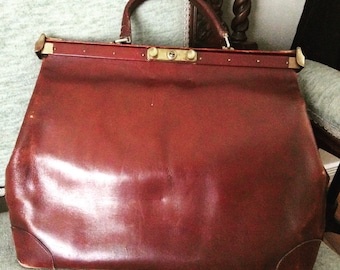 Beautifully weathered vintage leather satchel.