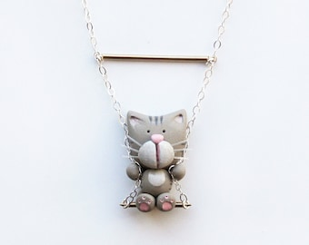 Simba the cat necklace on a swing -Sterling silver-