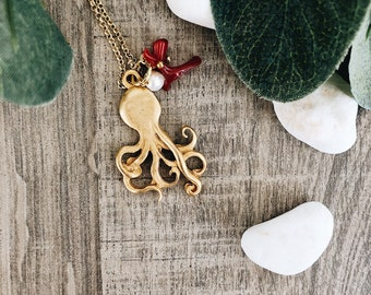 Necklace with octopus pendant in brass, corallini and beads