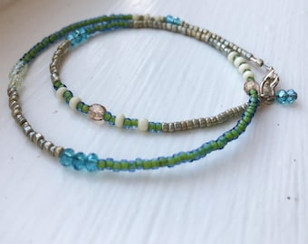Delicate, Stackable Blue and Green Beaded Bracelet With Glass Charm