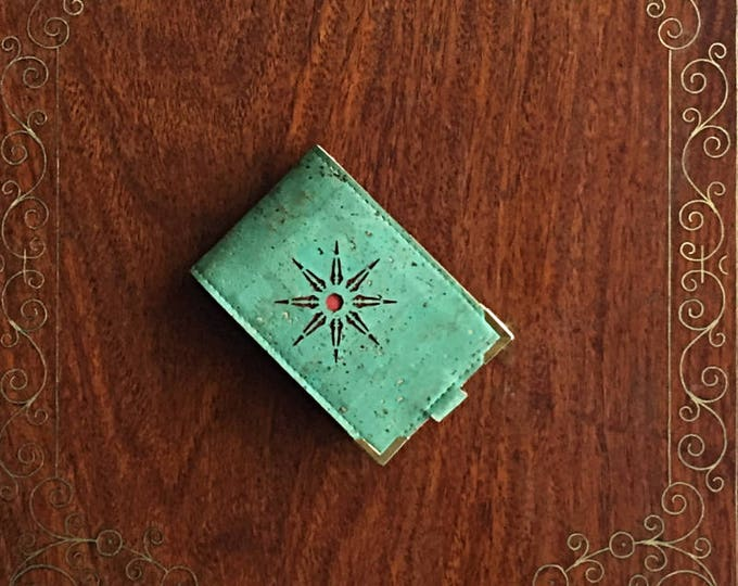 Mini card wallet made from vegan green cork leather/cork fabric enhanced with a geometric star design backed in red cork leather