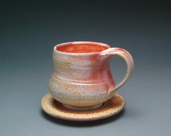 Wood Fired Tea or Coffee Cup and Matching Saucer with Orange Shino Liner Glaze and Beautiful Flashing