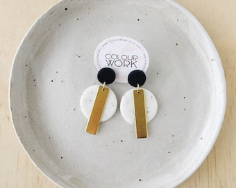 Circle Tag Earrings - Jet Black & White Granite with a brass rectangular bar.
