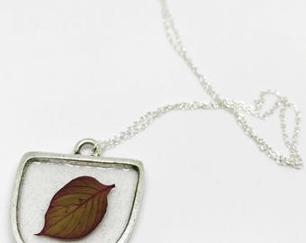 Red pressed leaf pendant on silver chain