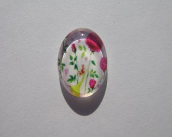 Oval glass cabochon 13 X 18 mm with the image of pink flowers