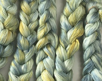 Hand-dyed, pre-wound, 8/2 Tencel weaving warp, 200 ends, 8 yards, in shades of blue, yellow, and pale green -109