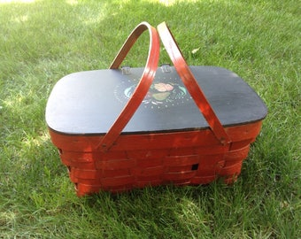 Vintage Red and Black Painted Picnic Basket. Wood hinged cover and swing handles. Woven wood picnic hamper.  Lid has Tole painted styling.