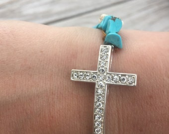 Turquoise and cream colored cross bracelet