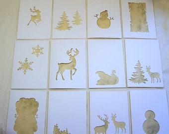 12 greeting cards/double cards with knockout natal / winter motifs