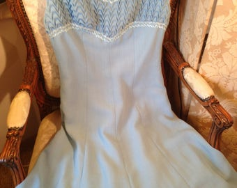Unusual 60's vintage pale blue crepe dress with sequin trim. Honeycomb finish. 36x30x42x38