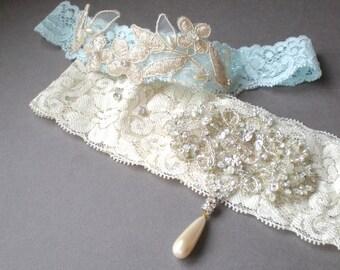Charming Ivory and Blue Lace Bridal Garters.. Elegant Golden Jeweled Rhinestones. Elongated Vintage Pearl Drop. Bridal Gift. Keepsake