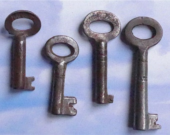 Skeleton keys, 4 different, antique.  4 small keys, different sizes for boxes etc., steel.  c late 19th. to very early 20th.
