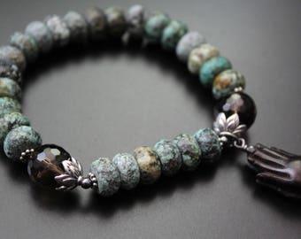 SALE Originally 58.00 Now 46.00 - African turquoise gemstone carved ebony wood praying hands charm tribal safari stretch spiritual bracelet