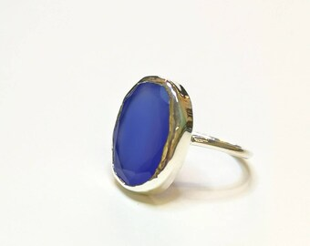 Ring with a faceted blue agate
