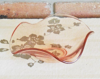 Salmon pink wave form small glass bowl made in England