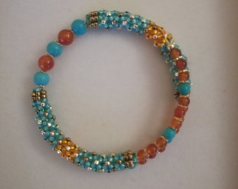 Handmade hand-sewn bracelet with glass beads and turquoise and carnelian pearls