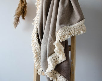 Handmade beige throw blanket with cream fringe