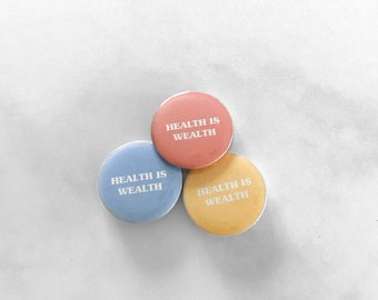 "HEALTH IS WEALTH 1"" pin"