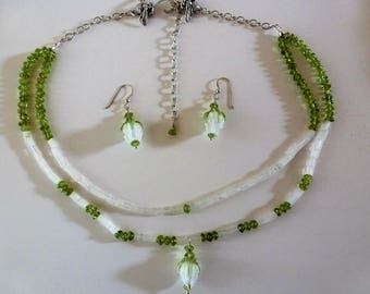 White Rosebud Necklace And Earrings are a delicate melange of Art Bead rosebuds, moonstones, and peridots on silver. Bob Burkett bees too!