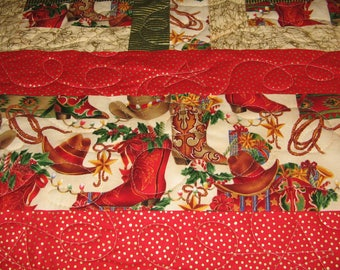 Christmas Cowgirl Boots and Hats 57X70 quilt done in fence rail block in Reds, Greens, Creme prints.
