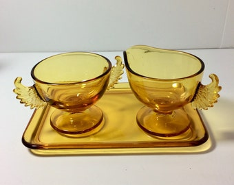 Gorgeous Vintage Winged Sugar and Creamer in Amber Glass
