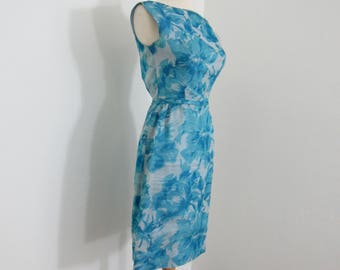 Lovely 1950s Turquoise Blue Floral Wiggle Dress with Graceful Wrap-Over Back & Rosette