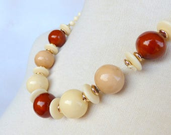 Beige brown gold multicolored vintage chunky bead necklace, 24 inch necklace, single strand plastic bead, resizable, costume jewelry.