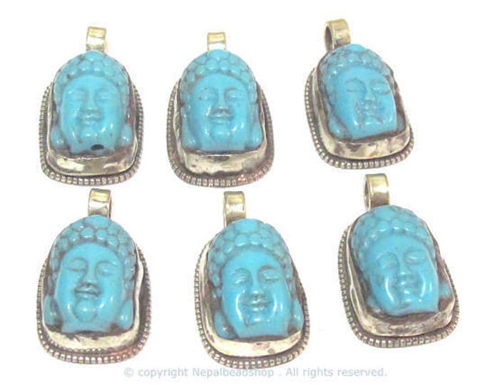 2 Pendants  - Small size Tibetan Nepal Buddha resin charm pendant with floral carving on other side  - PM590s Copyright Nepalbeadshop