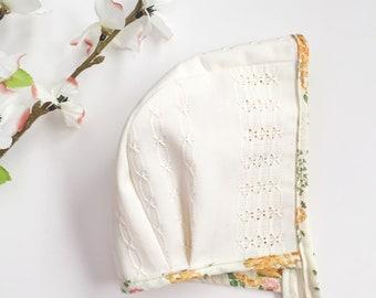 Cream and floral bonnet