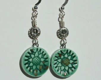 Polymer clay charm earrings with green flower