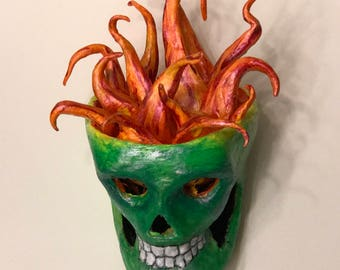 Flaming green skull