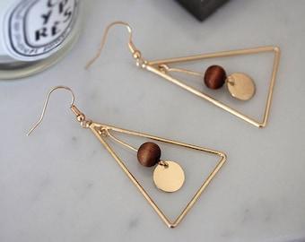 Dangling triangular earrings