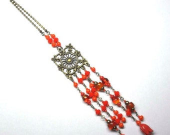 Collar necklace in orange glass beads, string and print bronze - coloured Collection