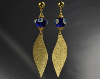 Handcrafted earrings, brushed gold fins, textured glass beads, post back