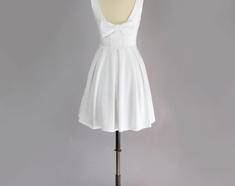 JANUARY - ivory white short wedding dress with back bow. vintage inspired fit and flare dress with pockets. ponte knit little white dress