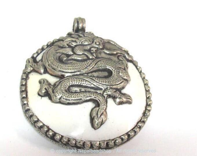 1 pendant - Large bold Tibetan Silver Repousse tribal naga conch shell pendant with tibetan dragon carving  - PM492B