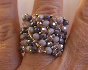 Maxi ring of crystals and beads in shades of purple.