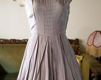 1950s tea length silver iridescent dress