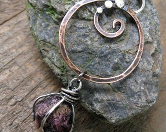 Copper and sterling silver Swirl pendant with large rough cut garnet sphere long necklace