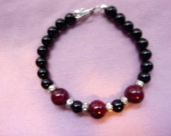 Men's black and dark red bracelet
