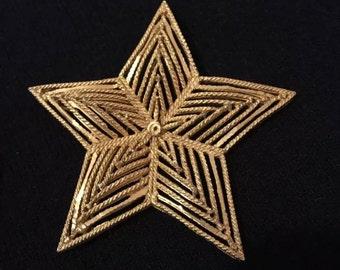 Vintage gold star brooch