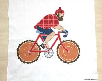 "Paul Bunyan Riding Bike Fabric 18"" Panel"