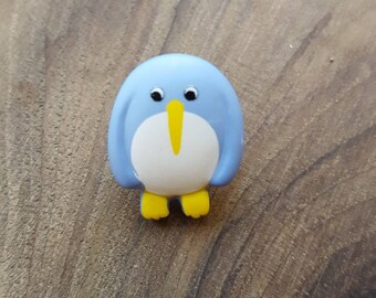 Bouton polyester fantaisie pingouin bleu
