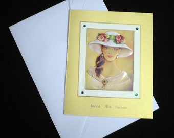 Gold and white card 'Lady in the white hat.