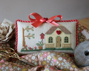 Handmade cross stitch pillow.  Perfect for displaying in a basket or to hang if desired