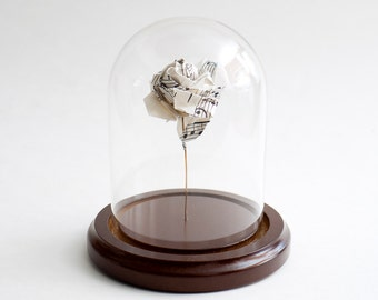 Origami rose in recycled music sheet small decorative globe