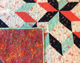 Turquoise, navy and red quilt
